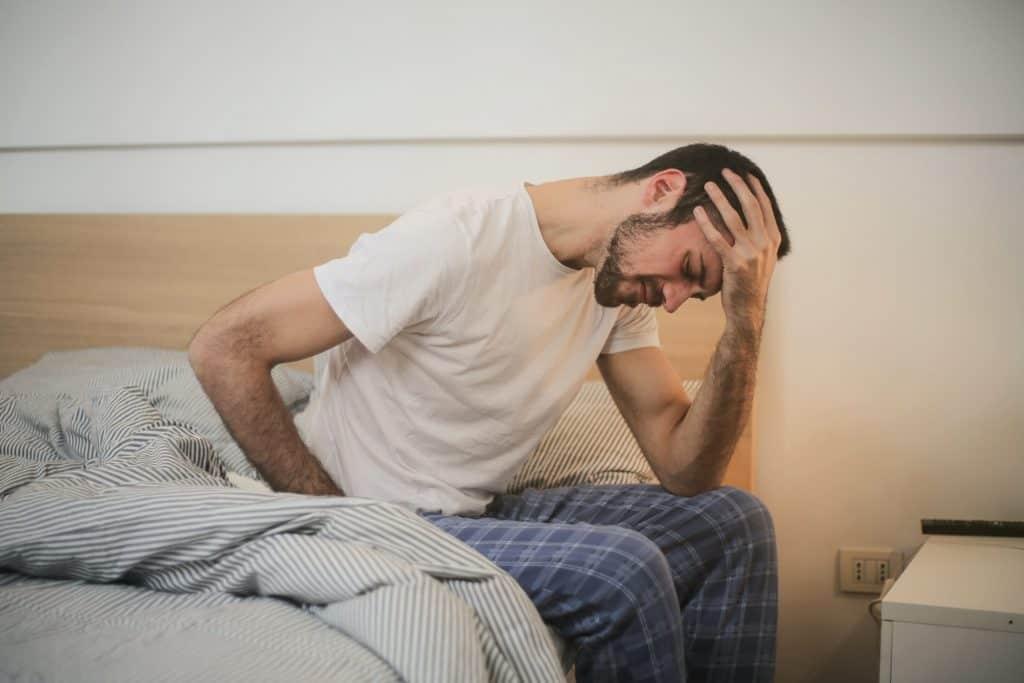 Man waking up tired