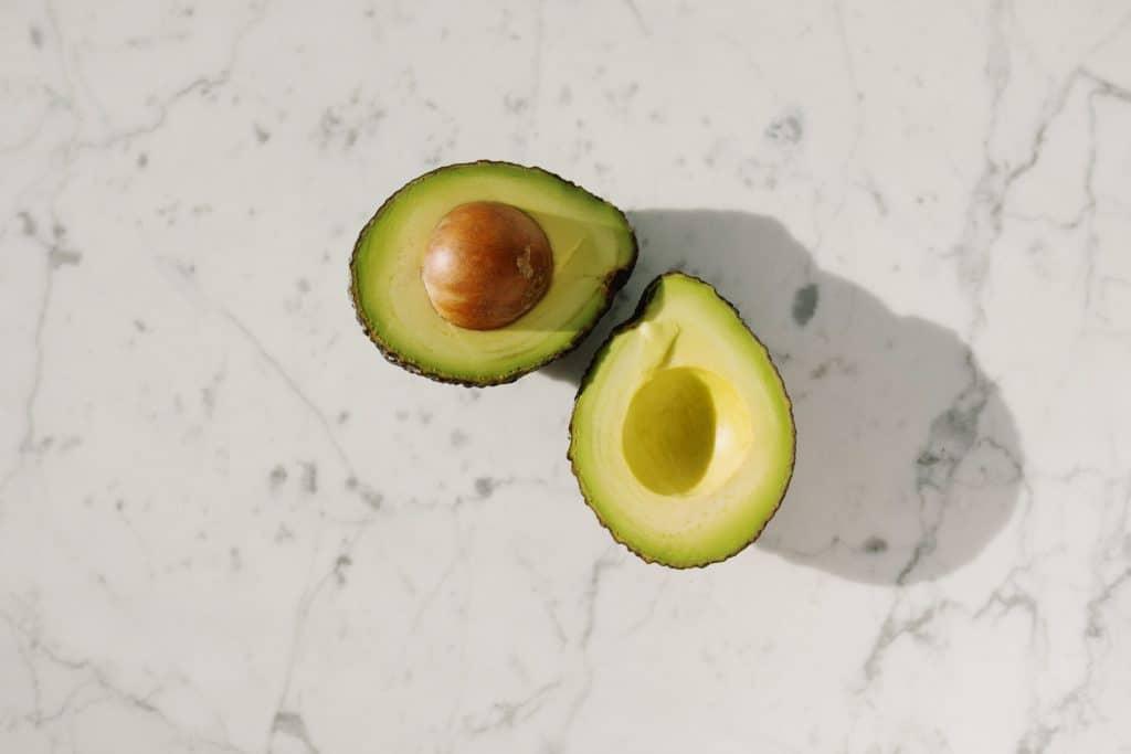 Split avocados on a countertop